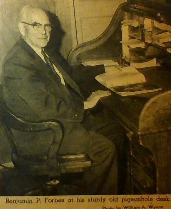 Black and White Photo of Benjamin P. Forbes Sitting at his desk