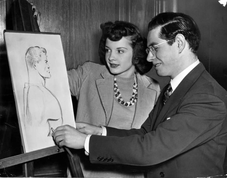 Joe Shuster, one of Superman's two creators, attends a freehand drawing course at Fenn College taught by Cleveland artist Hans Busch in 1942. At Shuster's left is fellow student Marian Henderson.