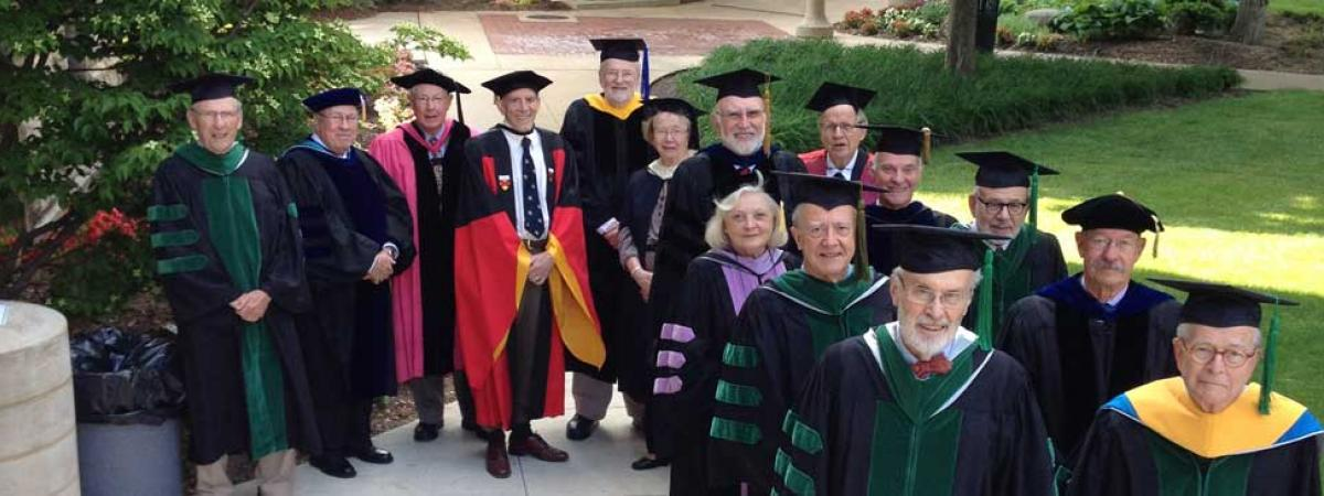 Group of emeriti professors standing.