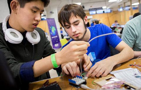 Two male students working on a project together