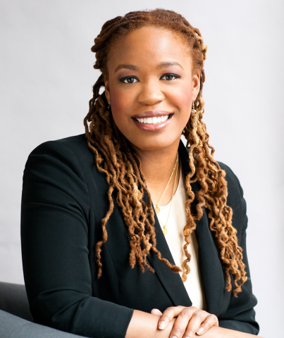 professional photo of Heather McGhee wearing a black blazer and smiling