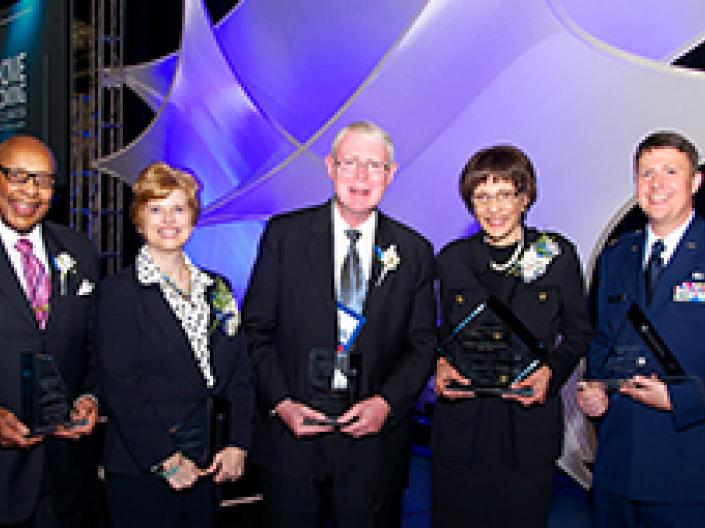 A group of Case Western Reserve University alumni award recipients holding their awards