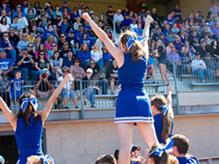 Case Western Reserve University cheerleaders cheering at a football game