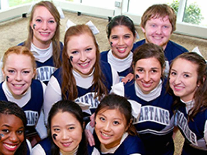 A group of smiling Case Western Reserve University cheerleaders