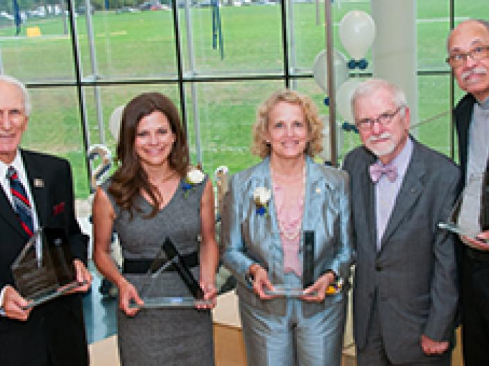 2015 Case Western Reserve University alumni award winners holding their awards