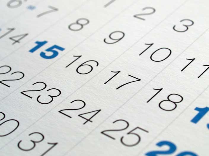 Stock image of a calendar with certain dates in bold