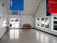 View of CWRU November Meeting Center lobby, with open windows, white walls and high roof