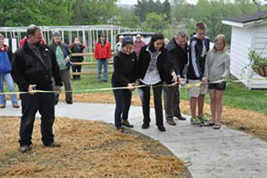 Ribbon cutting for opening of CWRU A.I. Root Observational Apiary and Pollinator Garden