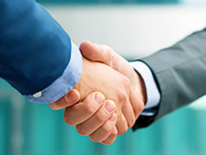 image of men shaking hands