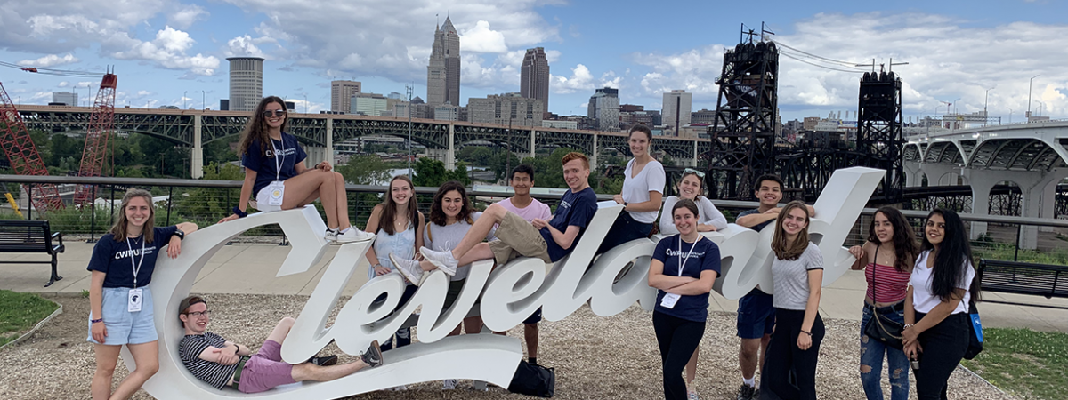 students posing around a Cleveland sign during the Discover Cleveland event