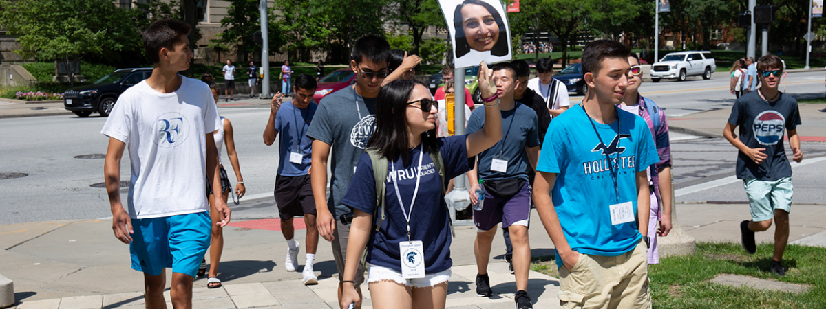 orientation leader walking with a group of students during Discover Week