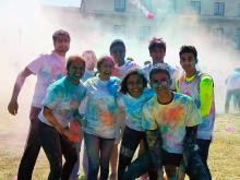 Case Western Reserve University students celebrating Holi shirts covered in colored powder