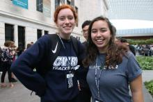 Case Western Reserve University track and field athlete with orientation leader inside Cleveland Art Museum Atrium