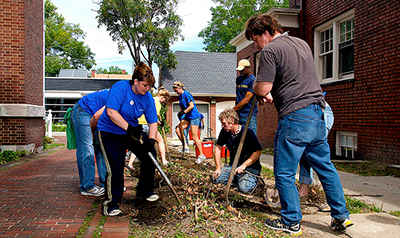 CWRU students and community members doing landscaping during Case for Community Day