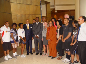 Congresswoman Marcia L. Fudge and former Congressman Louis Stokes with CWRU President Barbara R. Synder with representatives of the National Youth Sports Program at Case Western Reserve University
