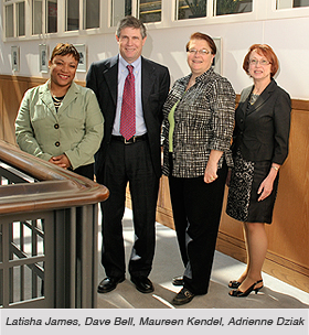 Hallway photo of Latisha James, Dave Bell, Maureen Kendel and Adrienne Dziak of CWRU Office of Government & Community Relations