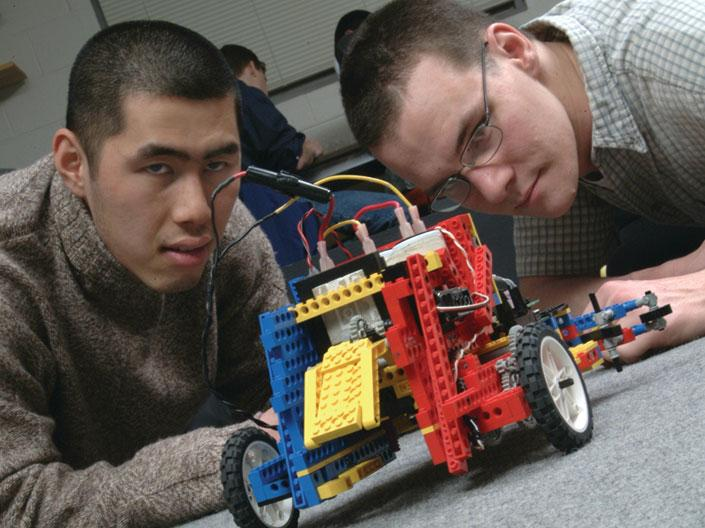 Two Case Western Reserve University students working on an electronic lego car