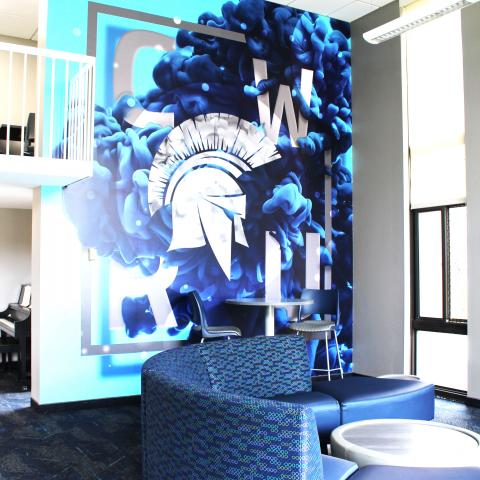 Clarke Tower Lounge with CWRU Mural and surrounding furniture