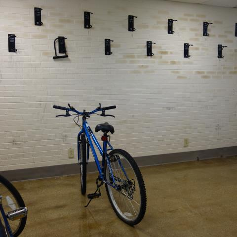 Smith House indoor bike storage room with wall-mounted bike hooks