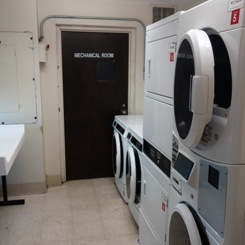 Taft House Laundry room showing stacked washing and drying machines