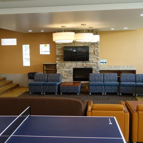 Taplin House Common Room showing furniture, television, and game tables