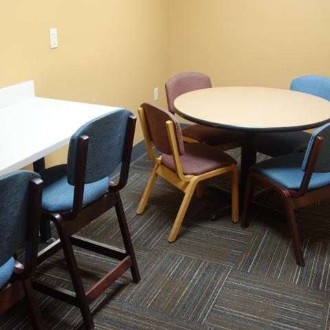 Taplin House Study Room with table, chairs, and bar stools