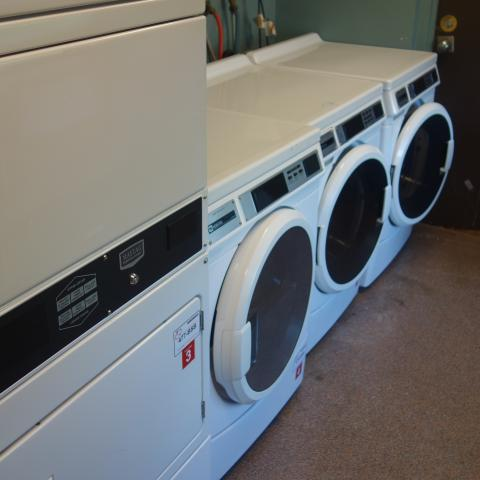 Taplin House Laundry Room with washing and drying machines