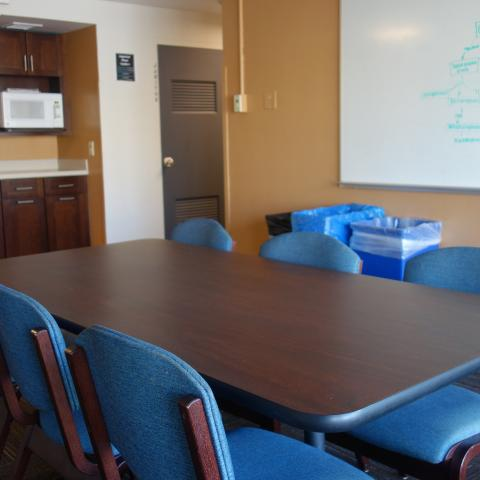 Taplin House 2nd Floor Lounge and Kitchenette showing white board, table, chairs, and microwave