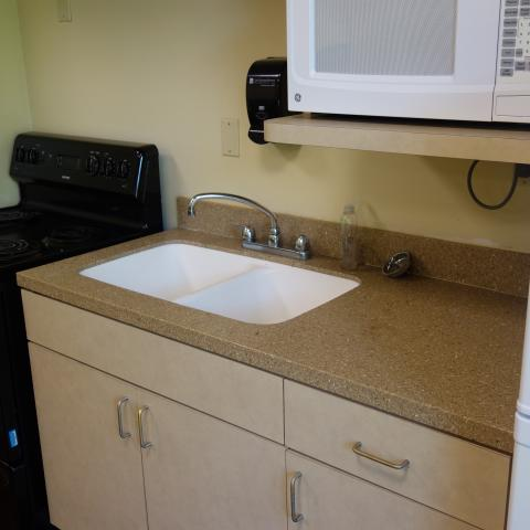 Tyler House 1st Floor Kitchen with oven, sink, microwave, and fridge
