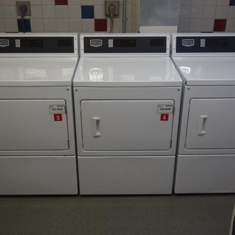 Tyler House Laundry Room with washing and drying machines
