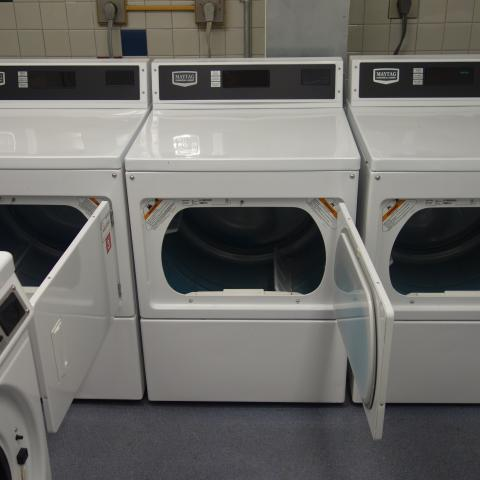 Sherman House Laundry Room with washing and drying machines