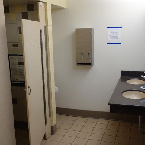 Cutler House Bathroom with urinal, shower stall, and sinks