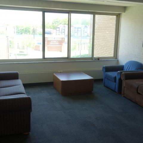 Cutler House Upper Floor Lounges with couches, coffee table, and white board