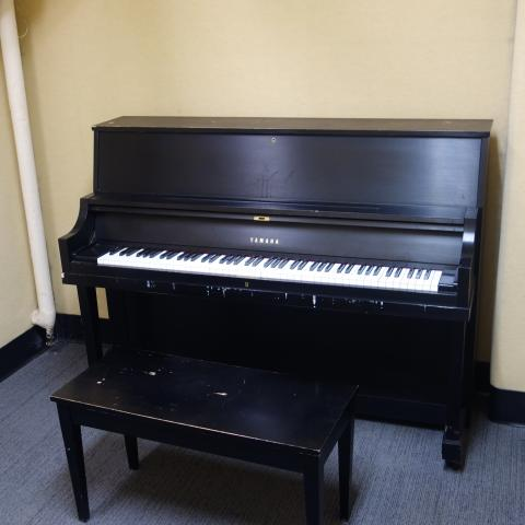 Kusch House Basement Practice Room showing common piano and bench