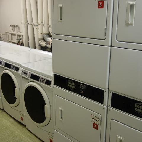 Glaser House Basement Laundry Room with washers and stacked dryers