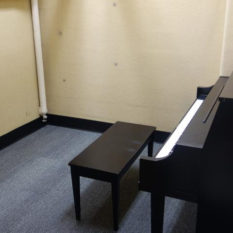 Glaser House Basement Practice Room with common piano and stool
