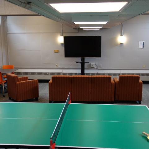 Michelson House Basement Lounge showing ping pong table, furniture and television
