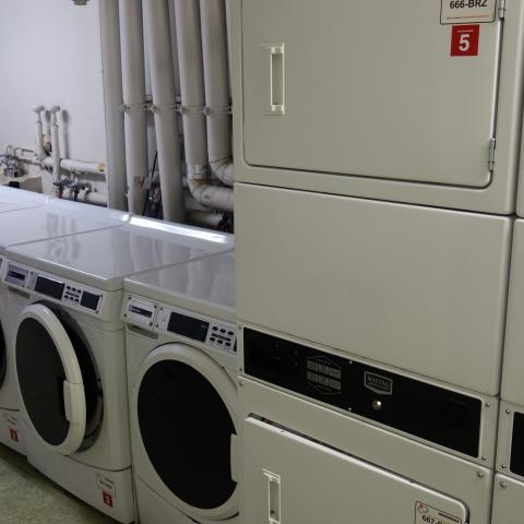 Michelson House Basement Laundry Room showing washers and stacked dryers