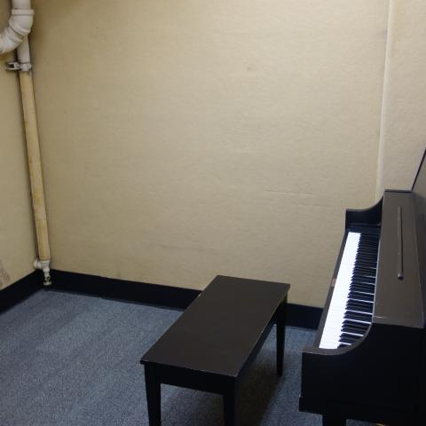 Michelson House Basement Practice Room showing common piano and bench