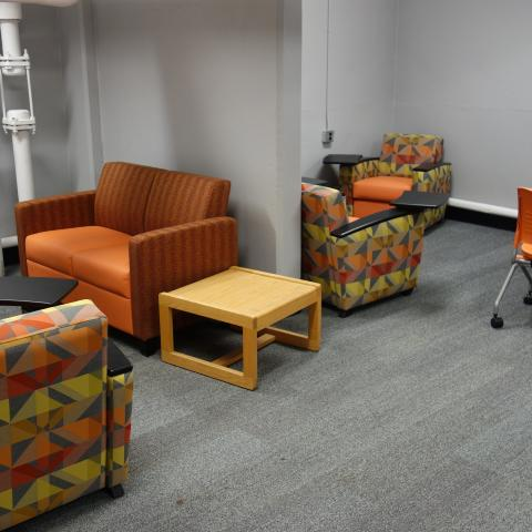 Michelson House Basement Group Study Lounge showing tables and chairs