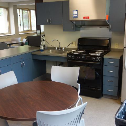 Tippit House Common Kitchen showing table, chairs, and appliances