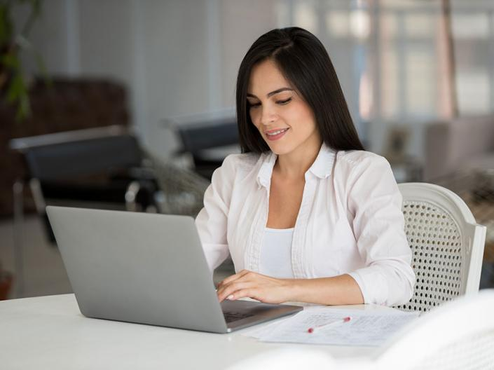 A women using a computer to search for a job.