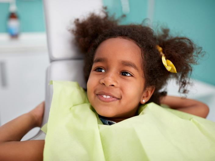 Child smiling after dental checkup.