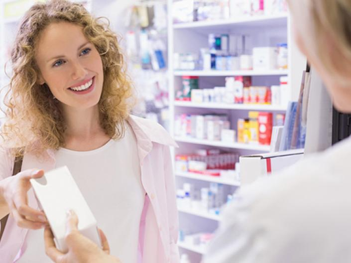 Woman picking up her prescriptions at the pharmacy