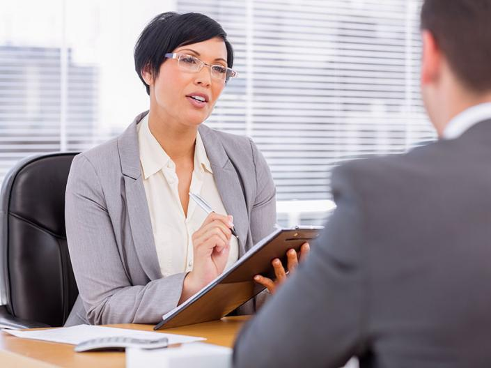 A female supervisor talking to an employee