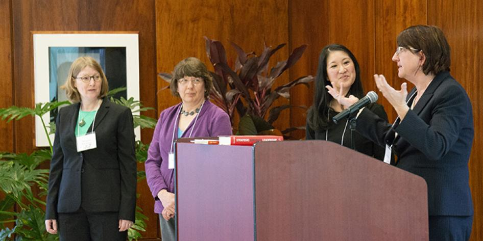 Group of women presenting at a podium during Annual Plenary 2018