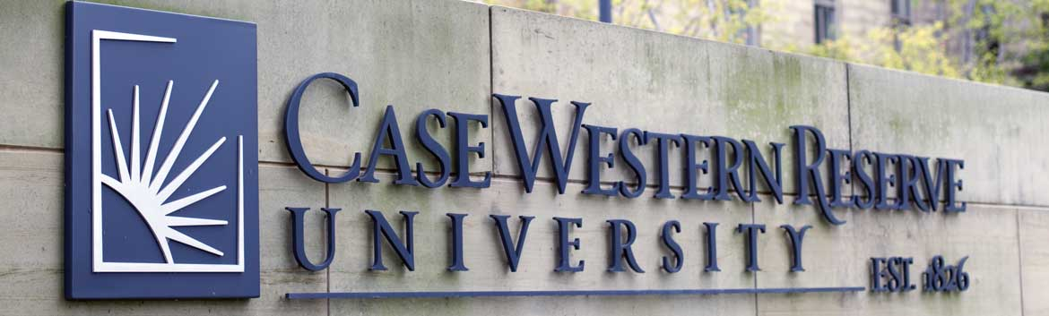 students crossing Euclid Ave. in front of the Case Western Reserve University sign