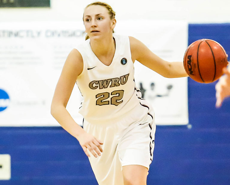 Case Western Reserve University women's basketball player dribbling the ball in a game against Chicago