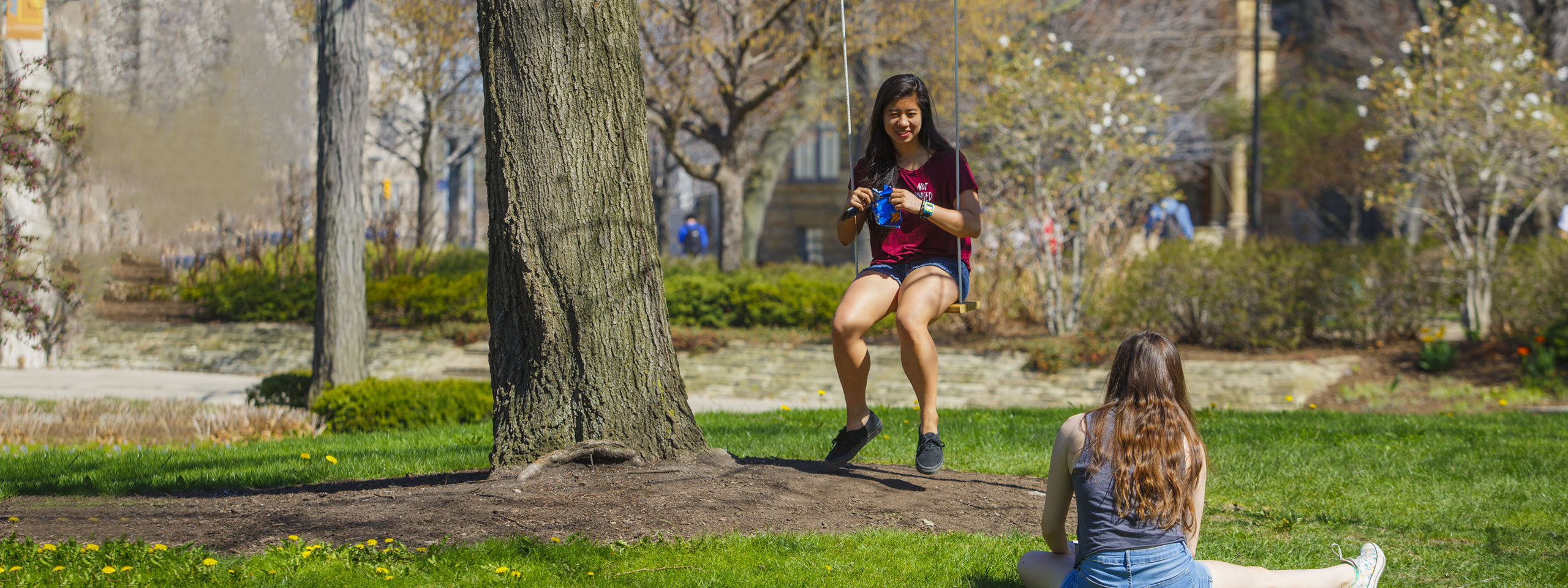 Photo of a girl swinging on campus