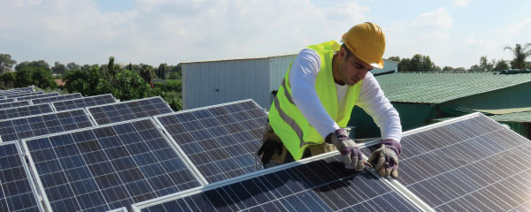 Photo of a person installing solar panels